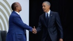 Former U.S. President Barack Obama, right, shakes hands with Patrice Motsepe, as he arrives at the Wanderers Stadium in Johannesburg, South Africa, Tuesday, July 17, 2018 to deliver the 16th Annual Nelson Mandela Lecture. (AP / Themba Hadebe)