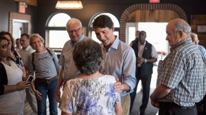 Prime Minister Justin Trudeau greets supporters while making a brief stop at Jimolly's Bakery & Cafe in Truro, N.S. on Tuesday, July 17, 2018. THE CANADIAN PRESS/Darren Calabrese