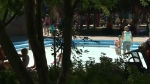 The wading pool in Eau Claire is a popular place to cool off from the heat.