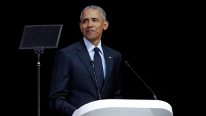 Former U.S. President Barack Obama, left, delivers his speech at the 16th Annual Nelson Mandela Lecture at the Wanderers Stadium in Johannesburg, South Africa, Tuesday, July 17, 2018. (AP Photo/Themba Hadebe)