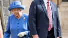 Queen Elizabeth II wears a brooch handed down by the Queen Mother, Elizabeth Bowes-Lyon, as she walks with U.S. President Donald Trump during his visit to Windsor Castle, Friday, July 13, 2018. (Richard Pohle/Pool Photo via AP)
