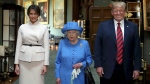 The Queen poses with Trump and his wife, Melania, in the Grand Corridor during their visit to Windsor Castle. (Steve Parsons/Pool Photo via AP)