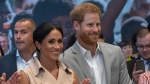 Britain's Prince Harry, second right, and Meghan the Duchess of Sussex attend the launch of the Nelson Mandela Centenary Exhibition, marking the 100th anniversary of anti-apartheid leader's birth, at the Queen Elizabeth Hall in London, Tuesday, July 17, 2018. (Arthur Edwards/Pool Photo via AP)