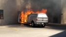 Flames and black smoke can be seen erupting from a pickup truck on Anne Street in Barrie, Ont. on Tuesday, July 17, 2018. (KC Colby/CTV News)