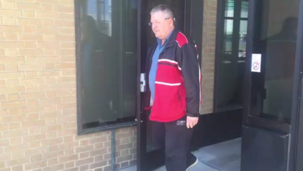 Drago Knezevic exiting a building