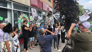 Striking SAQ workers demonstrate in Montreal on Tuesday, July 17, 2018. (Stéphane Giroux / CTV Montreal)