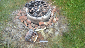 The SIU report says a melted five gallon gasoline container was found at the scene and the lighter used to ignite the gas was seized from the backyard by SIU forensic investigators. (Courtesy SIU)
