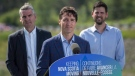 Prime Minister Justin Trudeau, centre, makes an announcement with Nova Scotia Premier Stephen McNeil, left, and MP for Central Nova Sean Fraser, of $90 million to improve the Trans-Canada Highway in the northeastern part of the province in Sutherlands River, N.S. on Tuesday, July 17, 2018. (THE CANADIAN PRESS/Darren Calabrese)
