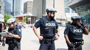 Police are seen in Toronto, on Thursday, July 12, 2018. (THE CANADIAN PRESS/Christopher Katsarov)