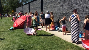 With less than half an hour before opening, the lineup outside the Borden Natural Swimming Pool stretched around the building. (Twitter/@JThompsonCTV)