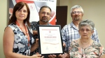 Gloria Warren Slade, Philanthropy Coordinator Canadian Red Cross Newfoundland and Labrador, left to right, Chris, Hazel and Howard Bullen pose as the Canadian Red Cross present a posthumous Rescuer Award to Leo Bullen in St. John's on Tuesday, July 17, 2018. Bullen died during a marine accident in 1972 when he gave his lifejacket to a young girl. (THE CANADIAN PRESS/Paul Daly)