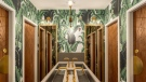 The washroom at Anh and Chi features a custom communal sink and wooden laser-cut doors.
