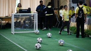 A mini soccer field being set up before a press conference on the 12 boys and coach realize from the hospital in Chiang Rai province, northern Thailand, Wednesday, July 18, 2018. (AP Photo/Vincent Thian)