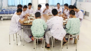 In this Sunday, July 15, 2018, file photo released by Thailand's Ministry of Health and the Chiang Rai Prachanukroh Hospital, some of the rescued soccer team members eat a meal together at a hospital in Chiang Rai, northern Thailand. The youth soccer teammates rescued from a flooded cave are expected to be released from the hospital Wednesday, July 18, 2018 and to speak about their ordeal. (Thailand's Ministry of Health and the Chiang Rai Prachanukroh Hospital, via AP)