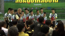 Boys rescued from flooding Thai cave