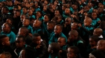 Children attend a special assembly to mark Mandela Day, at Melpark Primary School, in Johannesburg, Wednesday, July 18, 2018. (AP Photo/Denis Farrell)