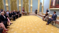 Governor General Julie Payette and Prime Minister Justin Trudeau sit during a swearing-in ceremony at Rideau Hall, Wednesday, July 18, 2018.