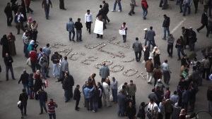In this Feb. 6, 2011 file photo, 'We are the men of Facebook' is written on the ground as anti-government protesters gather in Tahrir Square, in Cairo, Egypt. (AP Photo/Tara Todras-Whitehill, File)