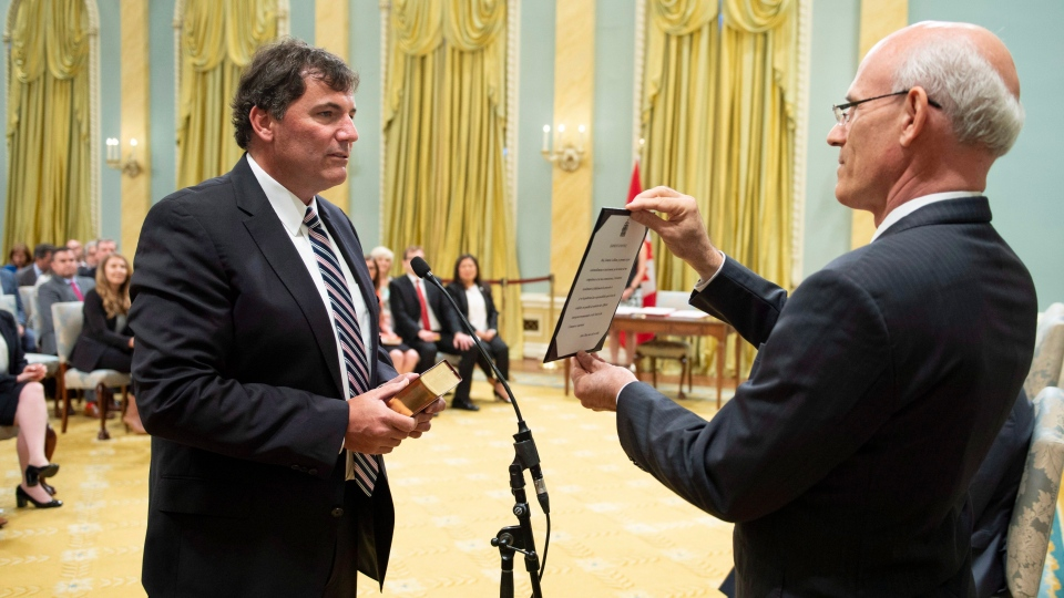 Dominic LeBlanc is sworn in as Minister of Intergovernmental and Northern Affairs and Internal Trade by Michael Wernick, clerk of the Privy Council, during a ceremony at Rideau Hall in Ottawa on Wednesday, July 18, 2018. (THE CANADIAN PRESS/Justin Tang)