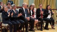 Francois-Philippe Champagne, Pablo Rodriguez, Bill Blair, Filomena Tassi, Jonathan Wilkinson and Mary Ng attend a swearing in ceremony at Rideau Hall in Ottawa on Wednesday, July 18, 2018. THE CANADIAN PRESS/Justin Tang