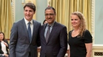 Amarjeet Sohi stands with Prime Minister Justin Trudeau and Governor General Julie Payette after being sworn in as Minister of Natural Resources, during a swearing in ceremony at Rideau Hall in Ottawa on Wednesday, July 18, 2018. (Justin Tang/ The Canadian Press)