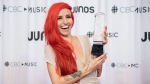 Lights celebrates her Juno win for Pop Album of the Year at the Juno Gala Dinner and Awards show in Vancouver, Saturday, March, 24, 2018. THE CANADIAN PRESS/Jonathan Hayward