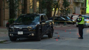 Toronto police officers investigate a fail-to-remain crash that they believe stemmed from a dispute between two drivers in the city's Entertainment District.