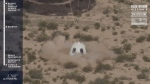 In this image from video made available by Blue Origin, the company's New Shepard capsule lands during a test in West Texas on Wednesday, July 18, 2018. (Blue Origin via AP)