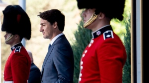 Prime Minister Justin Trudeau passes members of the Ceremonial Guard as he arrives for a press conference following a swearing in ceremony at Rideau Hall in Ottawa on Wednesday, July 18, 2018. THE CANADIAN PRESS/Justin Tang