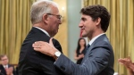 Bill Blair is congratulated by Prime Minister Justin Trudeau after being sworn in as Minister of Border Security and Organized Crime Reduction during a ceremony at Rideau Hall in Ottawa on Wednesday, July 18, 2018. (THE CANADIAN PRESS/Justin Tang)