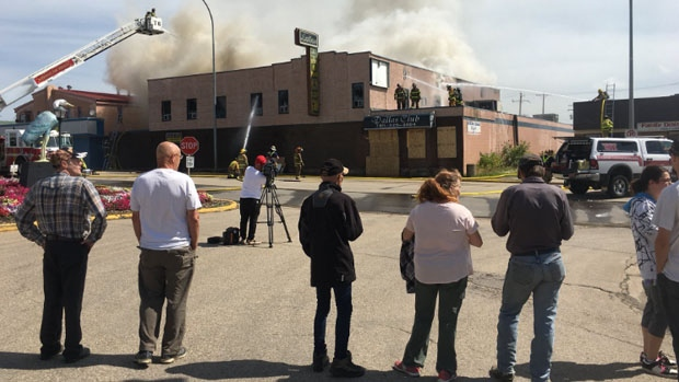 The Dallas Hotel, a landmark in the Barrhead community, in flames on Wednesday, July 18, 2018.