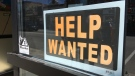 Help wanted signs are visible on Main Street in Huntsville, Ont. on Wednesday, July 18, 2018. (KC Colby/CTV News)