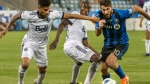 Montreal Impact's Ignacio Piatti, right, breaks away from Vancouver Whitecaps' Sean Franklin, left, and teammate Ali Ghazal during second half Canadian Championship action in Montreal on Wednesday, July 18, 2018. THE CANADIAN PRESS/Peter McCabe