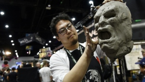 Sculptor Sam Gao works on a clay model during Preview Night of the 2018 Comic-Con International at the San Diego Convention Center in San Diego on Wednesday, July 18, 2018. (Chris Pizzello/Invision/AP)