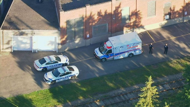 Police and paramedics near a set of train tracks in Brampton where a missing five-year-old boy was found suffering from critical injuries on July 19, 2018.