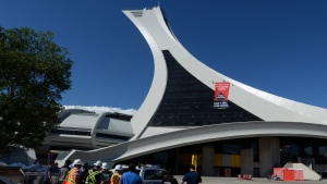 Greenpeace activists hang a banner from Olympic Stadium in Montreal, Thursday, July 19, 2018, protesting Canada's Trans Mountain pipeline expansion. THE CANADIAN PRESS/Ryan Remiorz