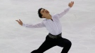 Denis Ten of Kazakhstan competes in the men's short program event during the ISU figure skating Eric Bompard Trophy at Bordeaux's skating arena, western France, Friday, Nov. 21, 2014. (AP Photo/Michel Euler)