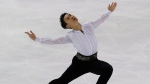 Denis Ten of Kazakhstan competes in the men's short program event during the ISU figure skating Eric Bompard Trophy at Bordeaux's skating arena, western France, Friday, Nov. 21, 2014. (AP Photo/Michel Euler)