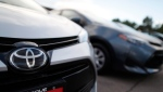 This Sunday, June 24, 2018 file photo shows the Toyota company logo on a car at a Toyota dealership in Englewood, Colo. (AP Photo/David Zalubowski, File)