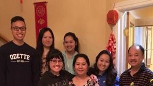 Binh Thanh Doan (right) and Ngoc Thi Tran (third from right) were killed in a car crash. They are survived by their five children. (Chi Doan / Facebook)