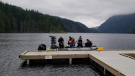 An  RCMP dive team is seen at Buntzen Lake, where a 19-year-old Surrey man drowned on Tuesday. (Handout)