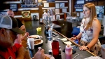 Kendra Snyder, right, talks with patrons at Checkers Bar & Grill in Mount Union, Pa., on Monday, July 16, 2018.  (AP Photo/Keith Srakocic)
