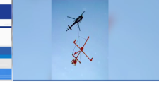 Helicopter conducting aerial resource survey