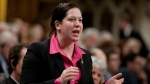 NDP MP Christine Moore rises in the House of Commons in Ottawa on Wednesday, April 4, 2012. THE CANADIAN PRESS/Adrian Wyld