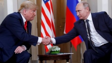 In this July 16, 2018, photo, U.S. President Donald Trump, left, and Russian President Vladimir Putin, right, shake hands at the beginning of a meeting at the Presidential Palace in Helsinki, Finland. (AP Photo/Pablo Martinez Monsivais)