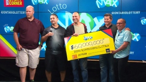 From left to right, Stephane Dionne, Gilles Dionne, Christopher Beazley, Bryan Redman and Norman MacDonald are presented with a $60-million cheque at the OLG prize centre in Toronto on July 19, 2018. (CTV News)