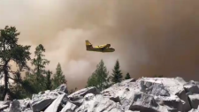 Waterbomber fighting the forest fire near Henvey Inlet First Nation