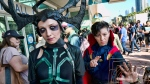 Tanya Dibrova, left, dressed as Marvel Comics character Hela, and Liz Torres, dressed as Doctor Strange arrive for Comic-Con International on Thursday, July 19, 2018, in San Diego. (AP / Richard Vogel)