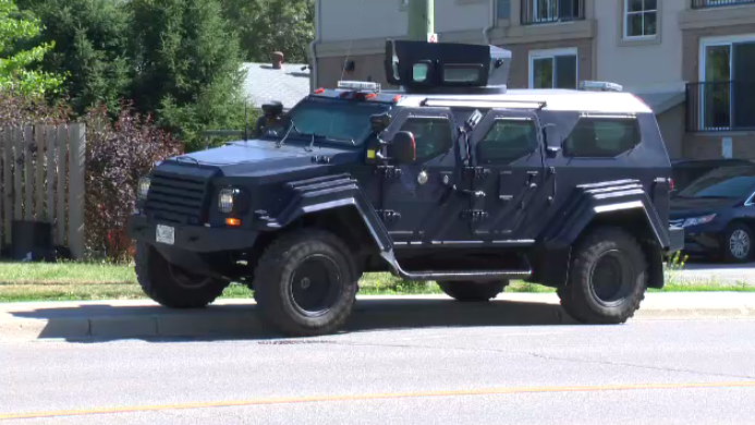 11 people facing weapons, drug charges following raid in