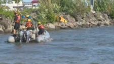 Rescue boats patrolled the waters off Centennial Park in search of a kayaker reported missing on Thursday July 19, 2018. His body was located in the evening.